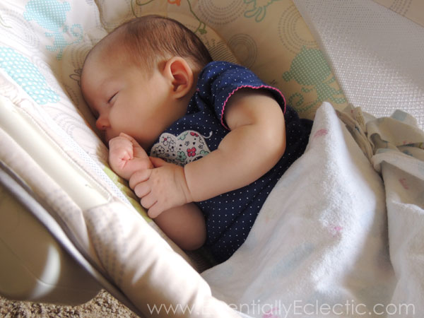 Breastfed baby with reflux asleep in a sleeper.