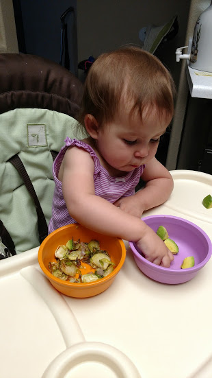Little Bo snacking on avocado chunks and roasted brussels sprouts