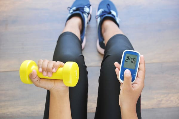 Woman exercising with glucose meter reading high blood sugar number. Only gestational diabetes testing will accurately let you know if you have high blood sugar in pregnancy.