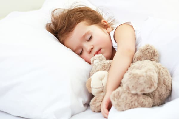 Young child sleeping after an early bed time