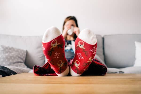 mom drinking coffee with Christmas socks on